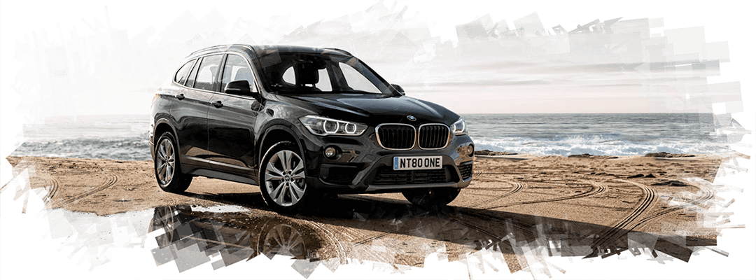 Sunny, warm Spain and one day on a beach. BMW X1.